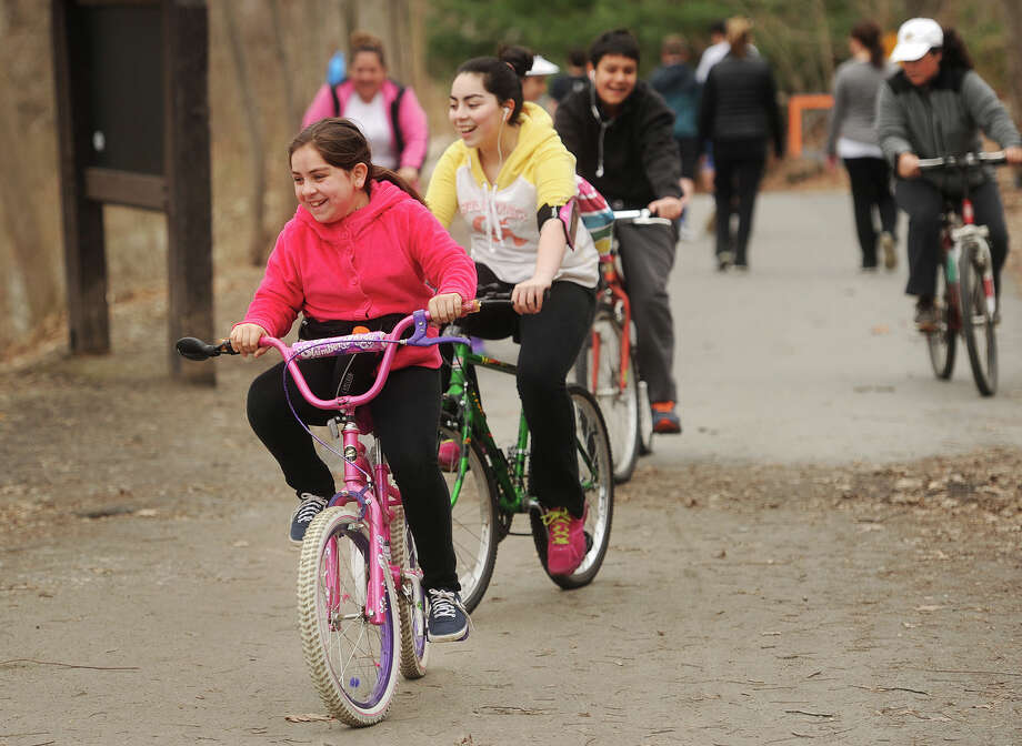 From left; Sofia Franco, 10, Maria Franco, Susana Franco, 13, Juan Alvarez, 14, and Maria Godoy, all of Bridgeport, enjoy biking the Housatonic Valley Rail Trail in Trumbull, Conn. on Tuesday, April 14, 2015. Photo: Brian A. Pounds / Connecticut Post