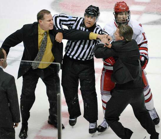Union head coach Rick Bennett, left, and RPI head coach Seth Appert, right, are pulled apart by a referee and RPI's Milos Bubela during a bench clearing brawl after RPI beat Union for the Mayor's Cup Saturday, Jan. 25, 2014, at the Times Union Center in Albany, N.Y.  (John Carl D'Annibale / Times Union) Photo: John Carl D'Annibale / 00025452A