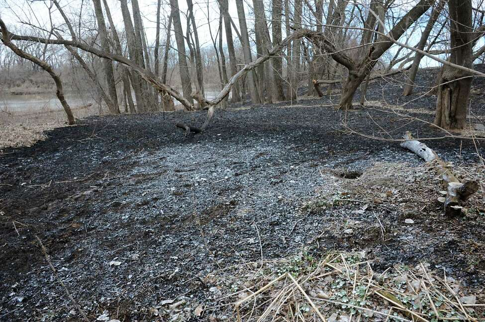 Charred ground from a brush fire between the bike path and the Mohawk River near Schenectady County Community College on Tuesday, April 14, 2015 in Albany, N.Y. (Lori Van Buren / Times Union)