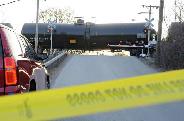 A man is detained by two police officers at the scene of a train and pedestrian accident on Monday, April 13, 2015 in Watervliet, N.Y. Earlier, a man taken to the hospital with a broken back and other injuries. (Lori Van Buren / Times Union) Photo: Lori Van Buren