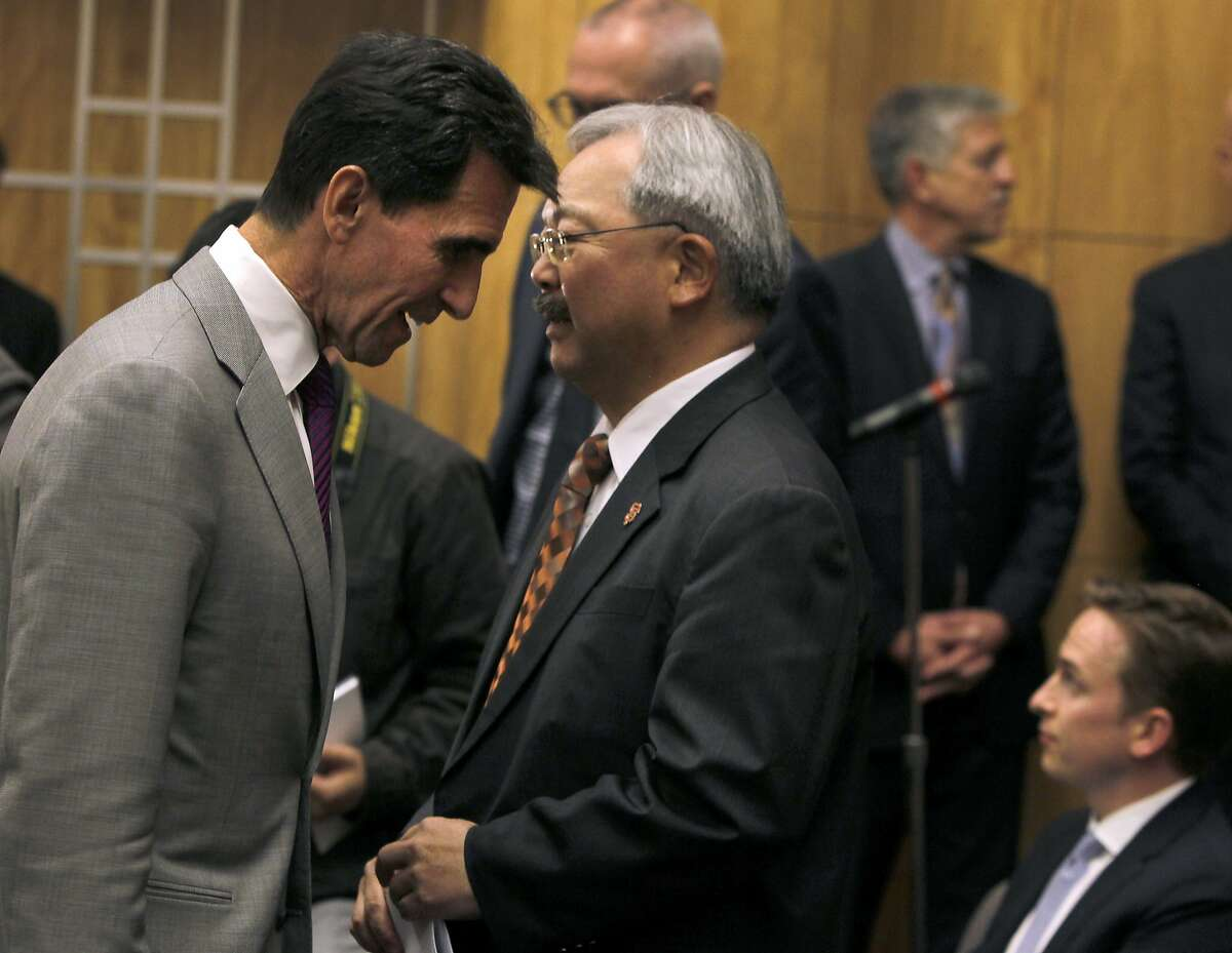 State Sen. Mark Leno confers with Mayor Ed Lee at a Senate Committee hearing to consider a bill to reform the Ellis Act within the city of San Francisco, at the State Capitol in Sacramento, Calif. on Tuesday, April 14, 2015. Leno authored SB 364.