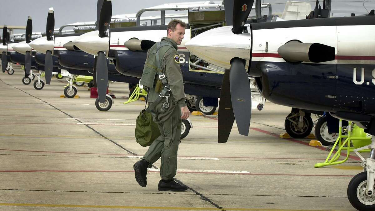 Air Force Pilot Steve Lyon inspects his T-6 trainer after a flight. The 12th Flying Training Wing will stand up the T-6A Texan Squadron at Randolph Air Force Base, Wednesday, Jan 16, 2002.
