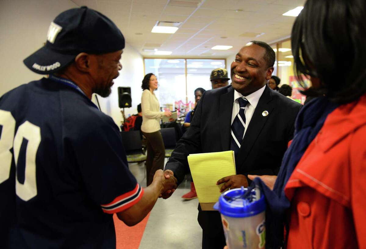 Student Guy Diaz, left, greets Dr. Paul Broadie, the new president of Housatonic Community College, during a student meet-and-greet event at the college in Bridgeport, Conn. on Tuesday Apr. 14, 2015.