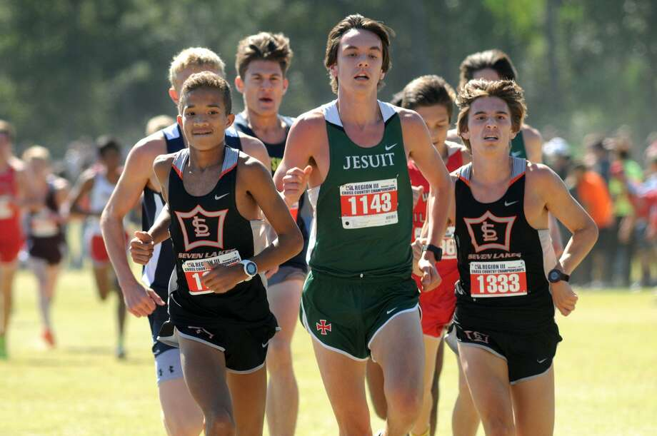 Seven Lakes senior Roderick Bell (1327), Strake Jesuit senior Blake Bordelon (1143), and Seven Lakes senior Chandler Rathke (1333) compete during the Boys 5K Run at the Region III-6A Cross Country Meet at Atascocita High School on Nov. 1st. Photo: Jerry Baker, Freelance