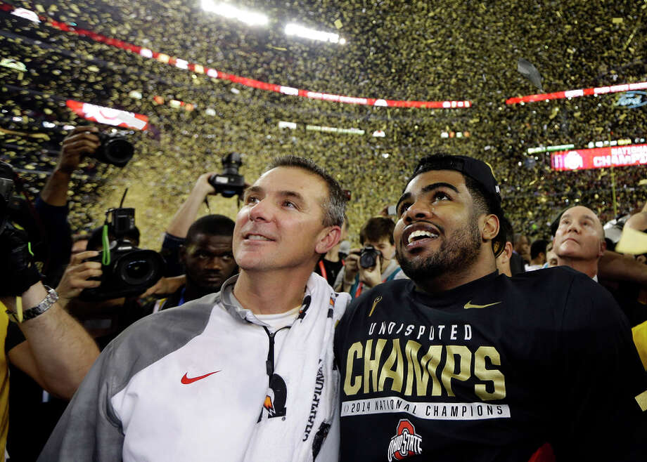 A win on the field for head coach Urban Meyer (left) and his Buckeyes was a win in the pocketbook for all FBS schools. Photo: David J. Phillip / Associated Press / AP