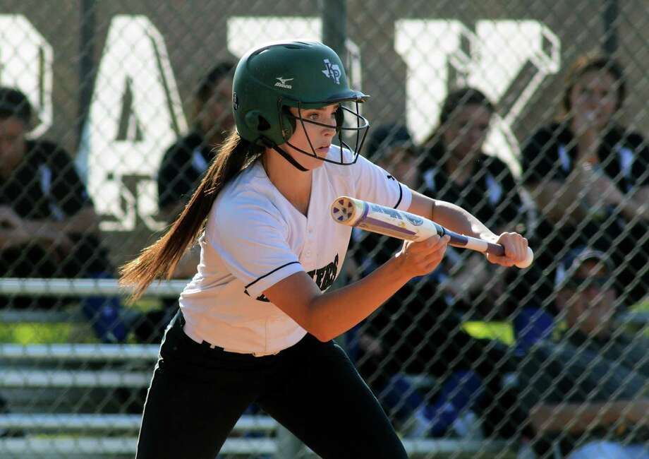 Kingwood Park third baseman Alyssa Hitt lays down a bunt against New Caney during their game at KPHS on April 13. Photo: Jerry Baker, Freelance