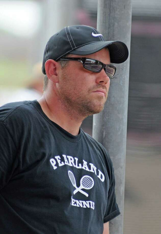 Pearland tennis coach Benjamin Stiles during the Class 5A Region III boys singles finals on April 20, 2011 in Deer Park. Pearland senior Daniel Hernandez (not pictured) won the match to qualify for state. Photo: L. Scott Hainline / freelance