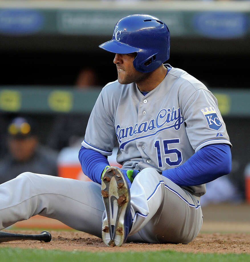 The Royals' Alex Rios looks toward the mound after he was hit  by a pitch in the eighth inning of Monday's game with the Twins. Photo: Tom Olmscheid / Associated Press / FR22905 AP