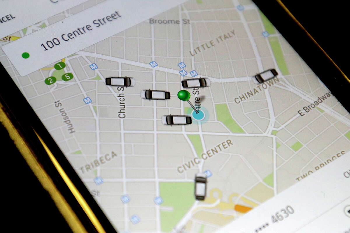 The Uber app displays cars available to make a pickup in downtown Manhattan on a smart phone, in New York. (AP Photo/Mary Altaffer)