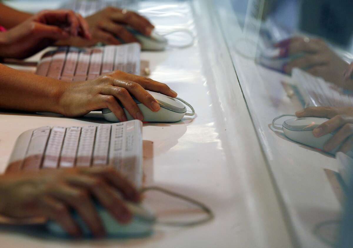 A 2013 file photo of users browsing the Internet in Hong Kong.