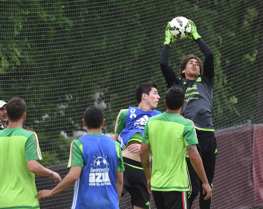 Mexico national team goalkeeper Guillermo Ochoa catches the ball during a corner kick during a practice at Trinity University on Tuesday, April 14, 2015. Photo: Billy Calzada, Staff / San Antonio Express-News / San Antonio Express-News