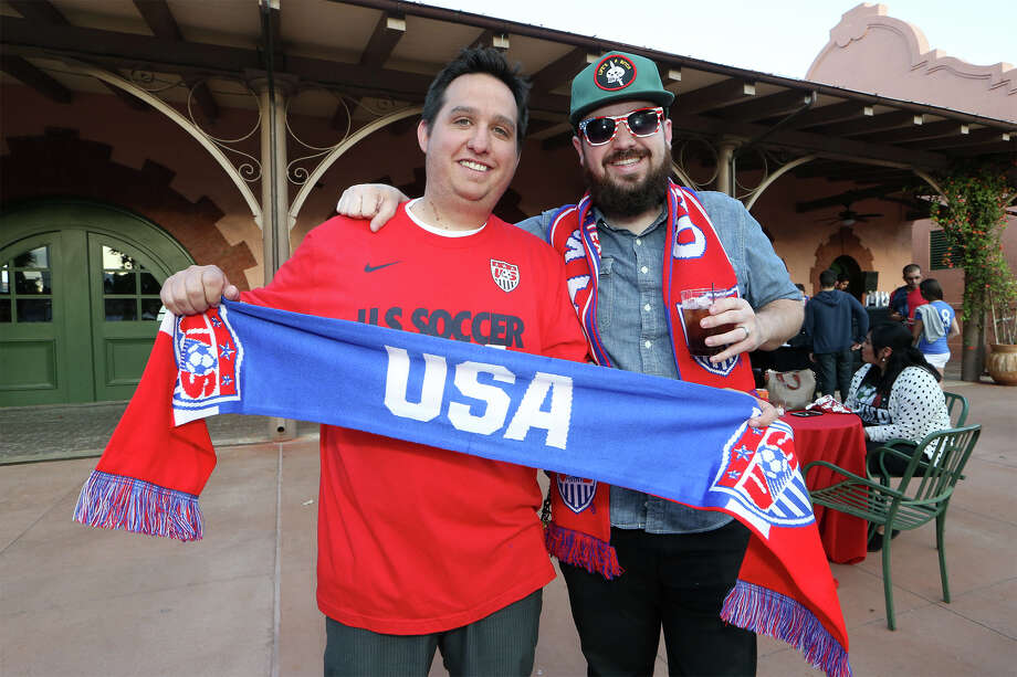 Dustin Slinker (left) and Dav ide Chitwood of Oklahoma City display a USA scarf while enjoying the fan fair at the U.S. Soccer Fan Headquarters at Sunset Station, 1174 E. Commerce, on Tuesday, April 14, 2015. The event featured art exhibitions, a fashion (sneaker show), open auditions for a Bud Light commercial, giveaways, contests, autograph signing and of course, food and beverages.  MARVIN PFEIFFER/ mpfeiffer@express-news.net Photo: Marvin Pfeiffer,  Staff / San Antonio Express-News / Express-News 2015
