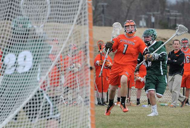 Bethlehem's Brad Bettinger is defended by Shenendehowa's Willy Stevenson as he makes a move to the net during a lacrosse game on Tuesday, April 14, 2015 in Delmar, N.Y. (Lori Van Buren / Times Union) Photo: Lori Van Buren / 00031426A