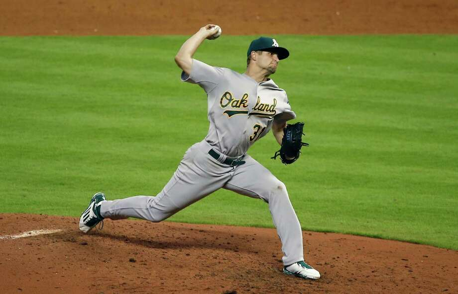 HOUSTON, TX - APRIL 14:  Kendall Graveman #31 of the Oakland Athletics throws a pitch in the sixth inning during their game against the Houston Astros at Minute Maid Park on April 14, 2015 in Houston, Texas.  (Photo by Scott Halleran/Getty Images) Photo: Scott Halleran / Getty Images / 2015 Getty Images