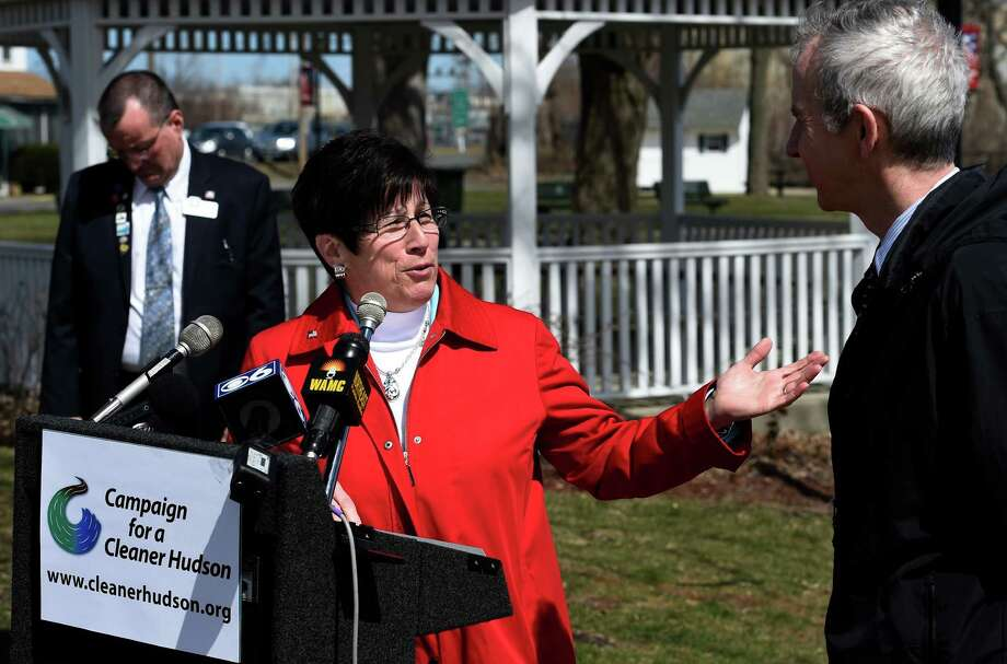 Green Island Mayor Ellen M. McNulty-Ryan welcomes elected officials and others to the Paine Street Park Tuesday morning April 14, 2015 in Green Island, N.Y.  to call upon General Electric to accept obligations beyond the partial cleanup of the Hudson River mandated by the EPA.   (Skip Dickstein/Times Union) Photo: SKIP DICKSTEIN / 00031410A