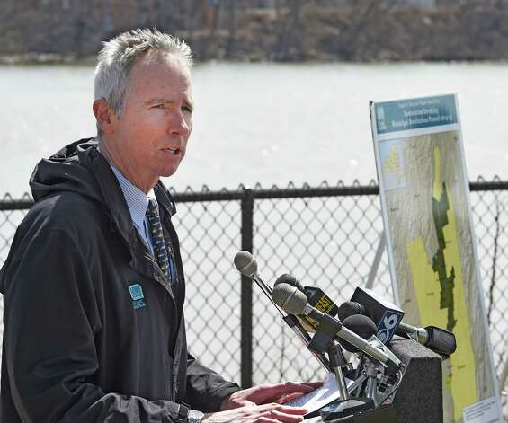 Scenic Hudson president Ned Sullivan speaks at the Paine Street Park Tuesday morning April 14, 2015 in Green Island, N.Y. and calls upon General Electric to accept obligations beyond the partial cleanup of the Hudson River mandated by the EPA.   (Skip Dickstein/Times Union) Photo: SKIP DICKSTEIN / 00031410A