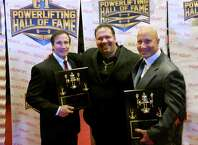 Jay Piccarillo,of the International Powerlifting Association, presents the 2014 Connecticut Powerlfiting Hall of Fame Award to Jim (left) and Dave Micik at a ceremony in New Haven.