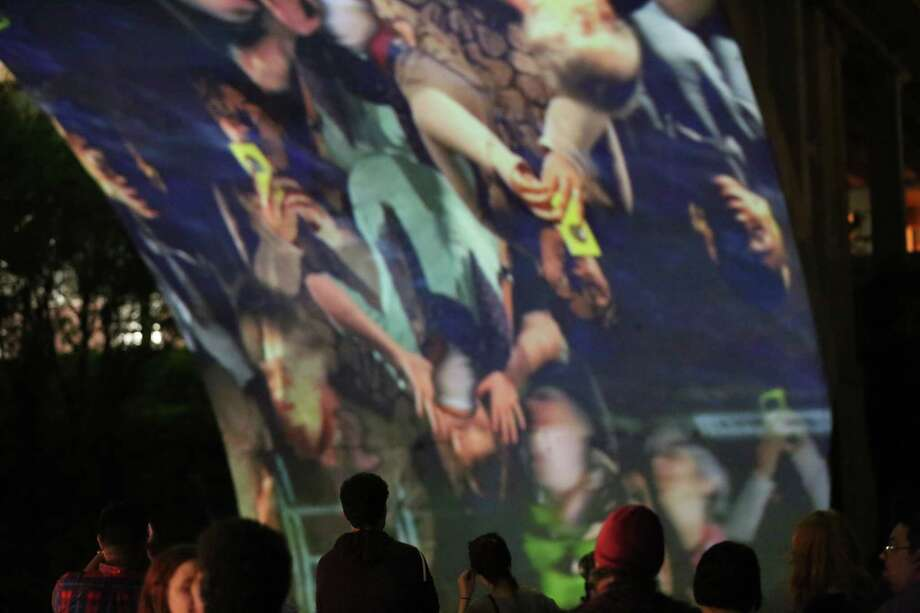 Austin artist Luke Savisky's video projection is seen under Allen's Landing Bridge on April 14 in downtown Houston. Multimedia artist Savisky returned to Houston with Ht/X, a live video spectacle, as part of the CounterCurrent festival that celebrates experimental art. Photo: Jon Shapley, Houston Chronicle / © 2015 Houston Chronicle