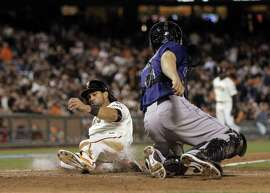Angel Pagan (16) scores on a Matt Duffy sacrifice fly in the eighth inning. The San Francisco Giants played the Colorado Rockies at AT&T Park in San Francisco, Calif., on  Tuesday, April 14, 2015.