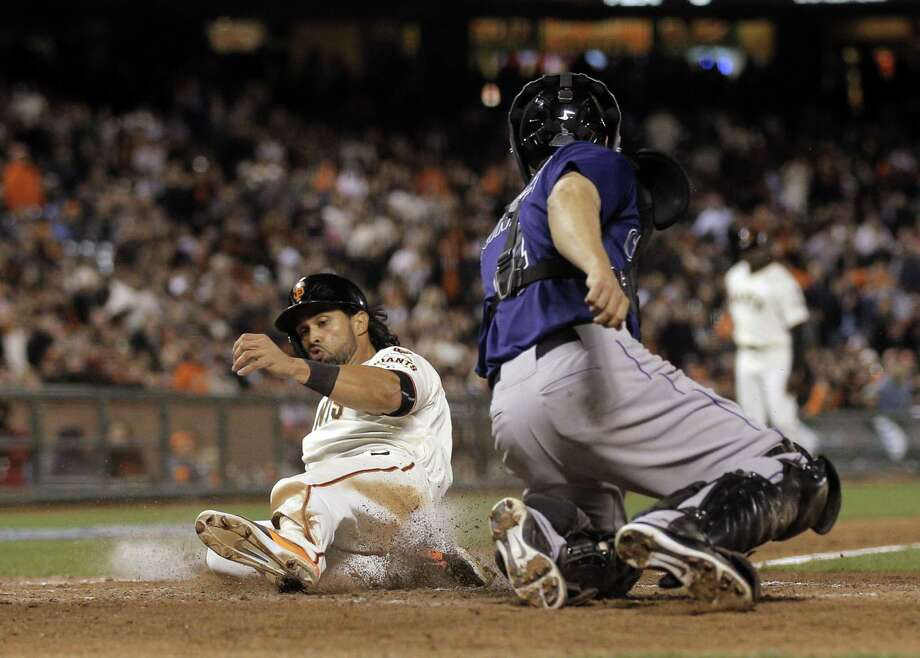Angel Pagan (16) scores on a Matt Duffy sacrifice fly in the eighth inning. The San Francisco Giants played the Colorado Rockies at AT&T Park in San Francisco, Calif., on  Tuesday, April 14, 2015. Photo: Carlos Avila Gonzalez / The Chronicle / ONLINE_YES