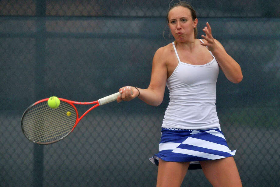 Ludlowe's Lindsey Evans, shown here in the FCIAC championships last spring, is off to a 4-0 start this season as the Falcons look to claim their third straight FCIAC and second consecutive Class L titles. Ludlowe defeated McMahon on Tuesday, led by Evans, who won 6-0, 6-1 over Rebecca Link.     returns the ball to Greenwich's Anna Daccache during their FCIAC championship tennis match at Wilton High School in Wilton, Conn., on Wednesday, May 28, 2014. Fairfield Ludlowe won the team title. Evans won most valuable player of the tournament. Photo: Jason Rearick / Stamford Advocate