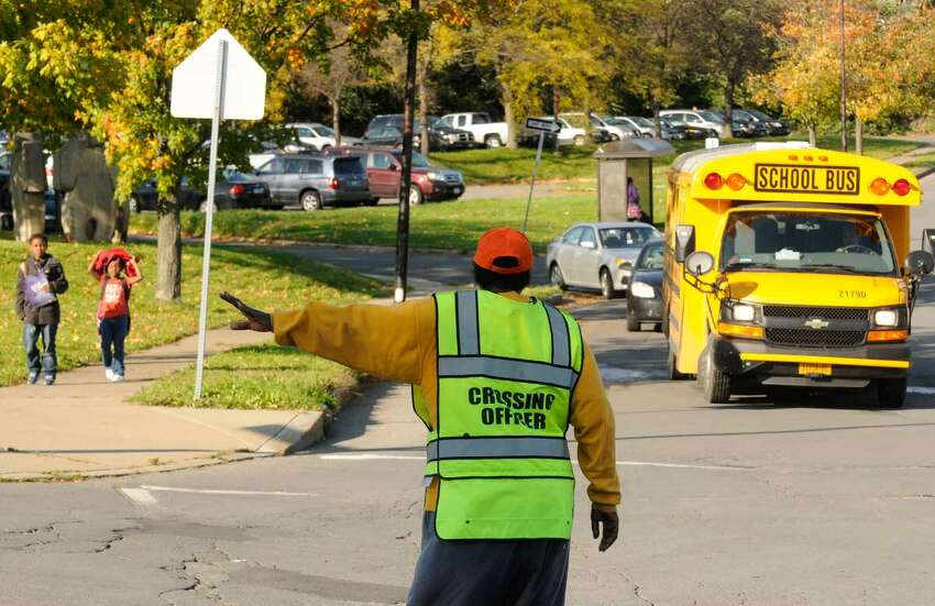Delores Traynham an Albany school crossing guard for 11-years works the corner of Arbor and Lark Drives near Arbor Hill Elementary School in Albany, NY Thursday, Oct. 20, 2011.( Michael P. Farrell/Times Union) ORG XMIT: MER2015041415590917