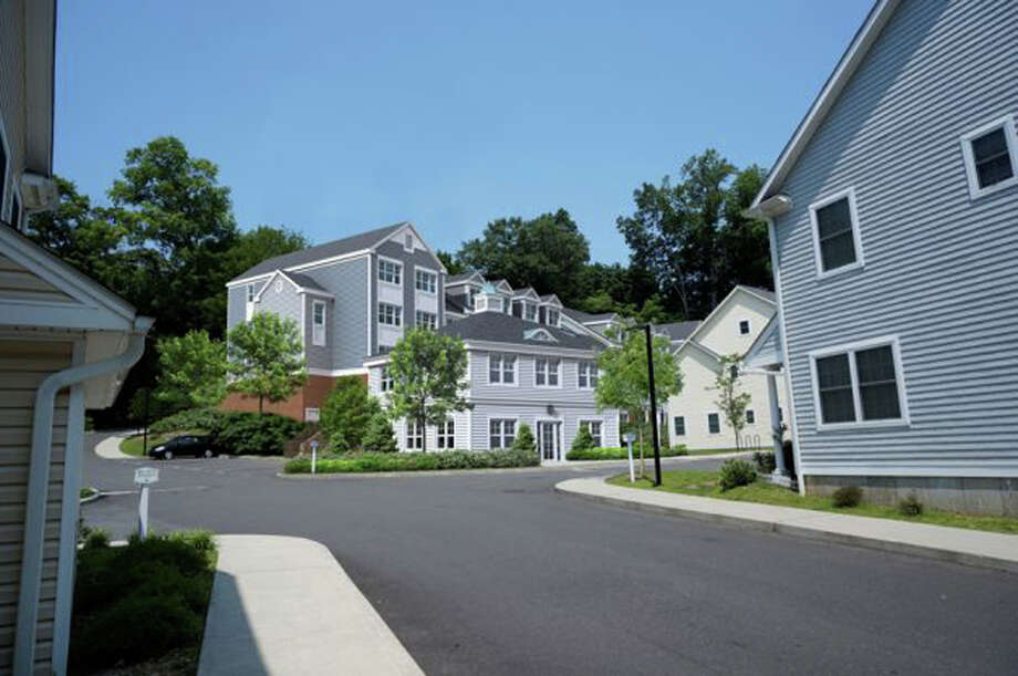 A view of what proposed new units at Millport Apartments would look like from the entrance on Millport Avenue in New Canaan. The New Canaan Housing Authority is seeking to replace the existing 22 units on top of the hill with more than 70 new ones. Photo: Contributed Photo / New Canaan News