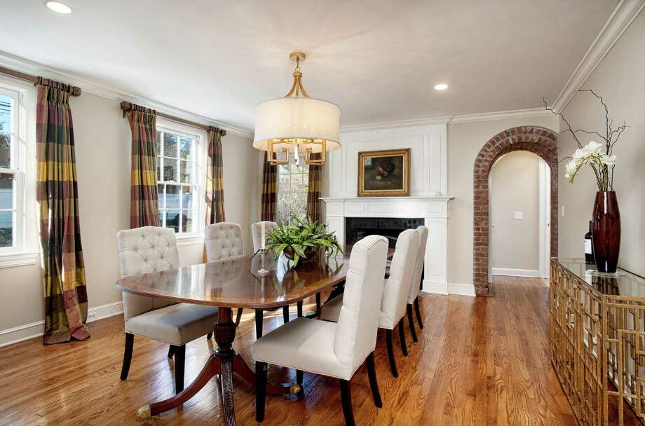 An oversized dining room with a work burning fireplace and an exposed brick archway Photo: Contributed Photo, SR Photo, LLC / © SR Photo, LLC All Rights Reserved