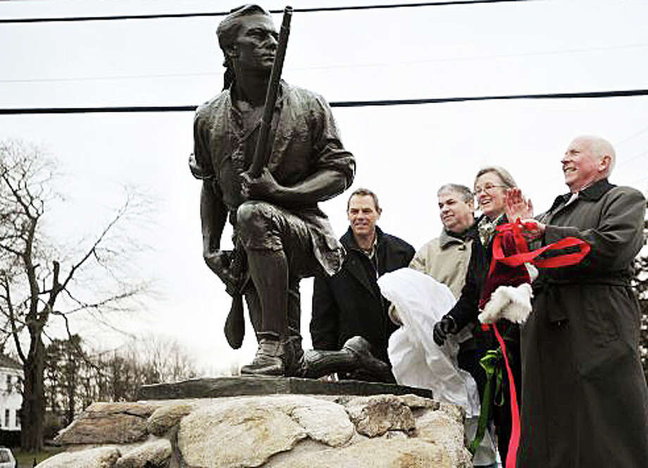 The Minute Man monument was unveiled last December following a months-long restoration, as First Selectman Jim Marpe, right, and others admired the 105-year-old icon. Photo: File Photo / Westport News