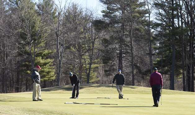 Golfers take to the course on opening day at Saratoga National Golf Club on Wednesday, April 15, 2015. (Skip Dickstein/Times Union)