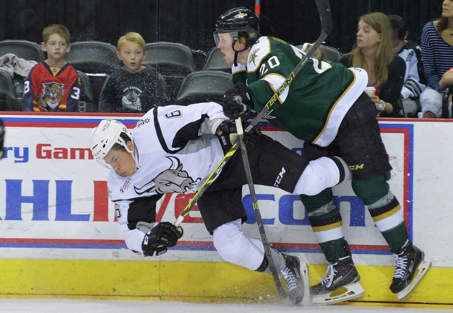 Stars winger Brett Ritchie takes down Rampage defenseman Jonathan Racine during the third period. The teams will face off in the final two games of the season on Friday and Saturday. Photo: Darren Abate / AHL / Darren Abate/AHL