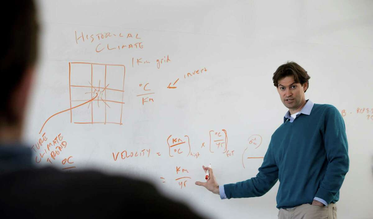 Dr. Noah Diffenbaugh makes remarks during a lab meeting at Stanford University in Palo Alto, Calif. on Tues. April 14, 2015. Diffenbaugh is an Associate Professor of Earth System Science and Senior Fellow at the Woods Institute for the Environment at Stanford University.