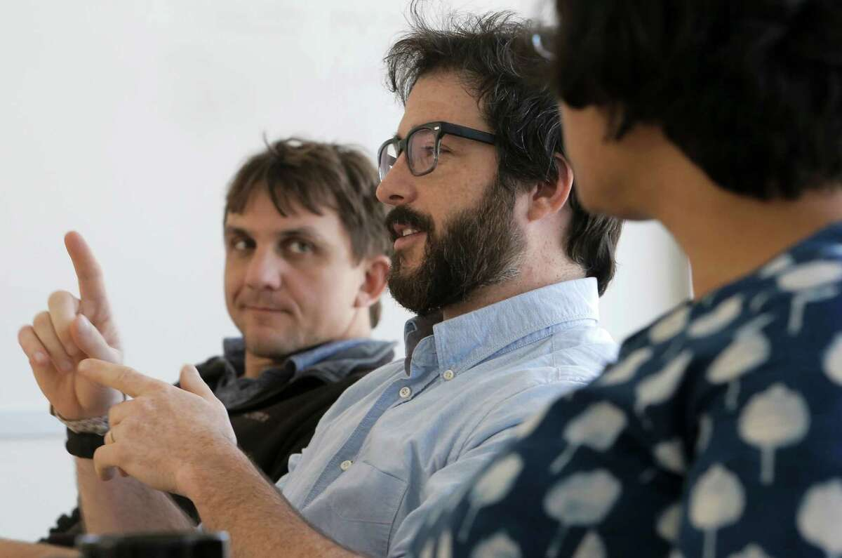 Postdoctoral student Daniel Horton, (left) and Deepti Singh, (right) a graduate student listens to remarks by Justin Mankin, (center) a graduate student during a lab meeting at Stanford University in Palo Alto, Calif. on Tues. April 14, 2015.