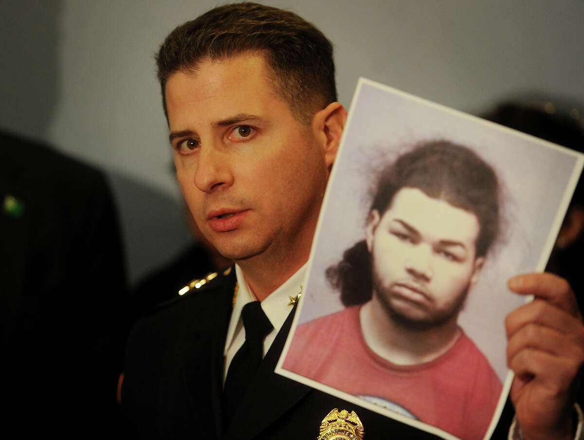 Bridgeport Assistant Police Chief James Nardozzi holds a photo of Treizy Lopez, 18, of New Haven, wanted for the murder of Jose Salgado at his Sapiao's Grocery Store in Bridgeport's Hollow neighborhood on Saturday, at the Margaret Morton Government Center in Bridgeport, Conn. on Wednesday, April 15, 2015.