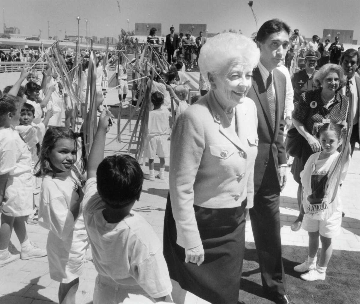 Governor Ann Richards walks with HUD Secretary Henry Cisneros at the Alamodome opening ceremonies on May 16, 1993.