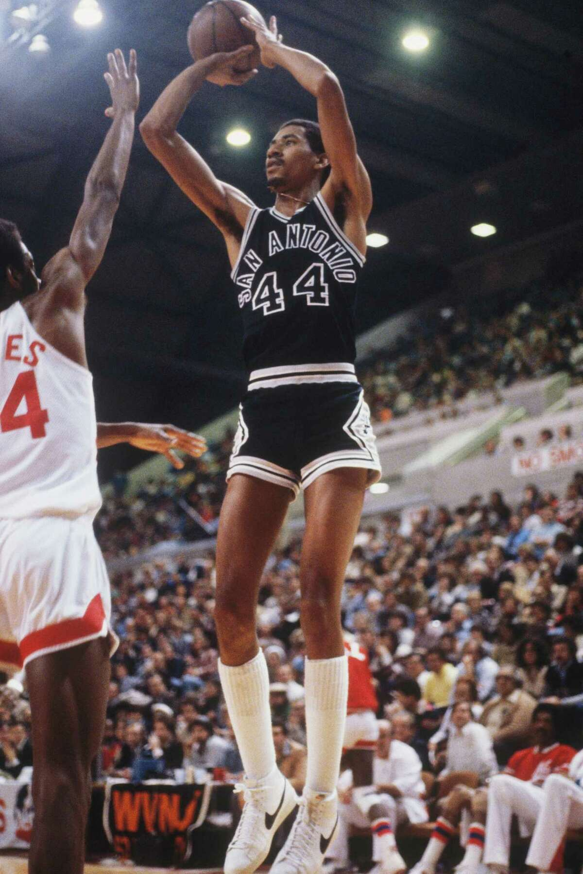Spurs' George Gervin makes a jump shot circa 1970s during a game against the Nets.