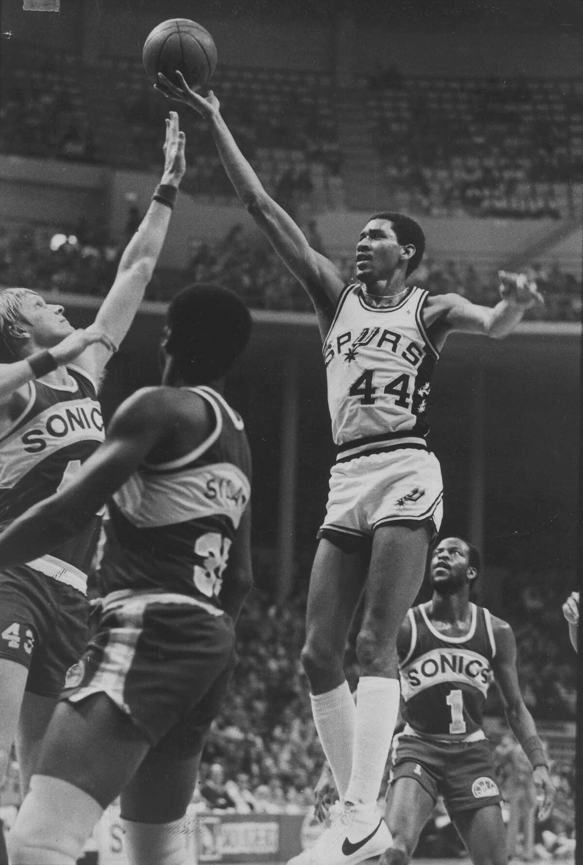 The Spurs' George Gervin goes up for his trademark finger roll in 1979 in an NBA game at HemisFair Areana against the Seattle SuperSonics.