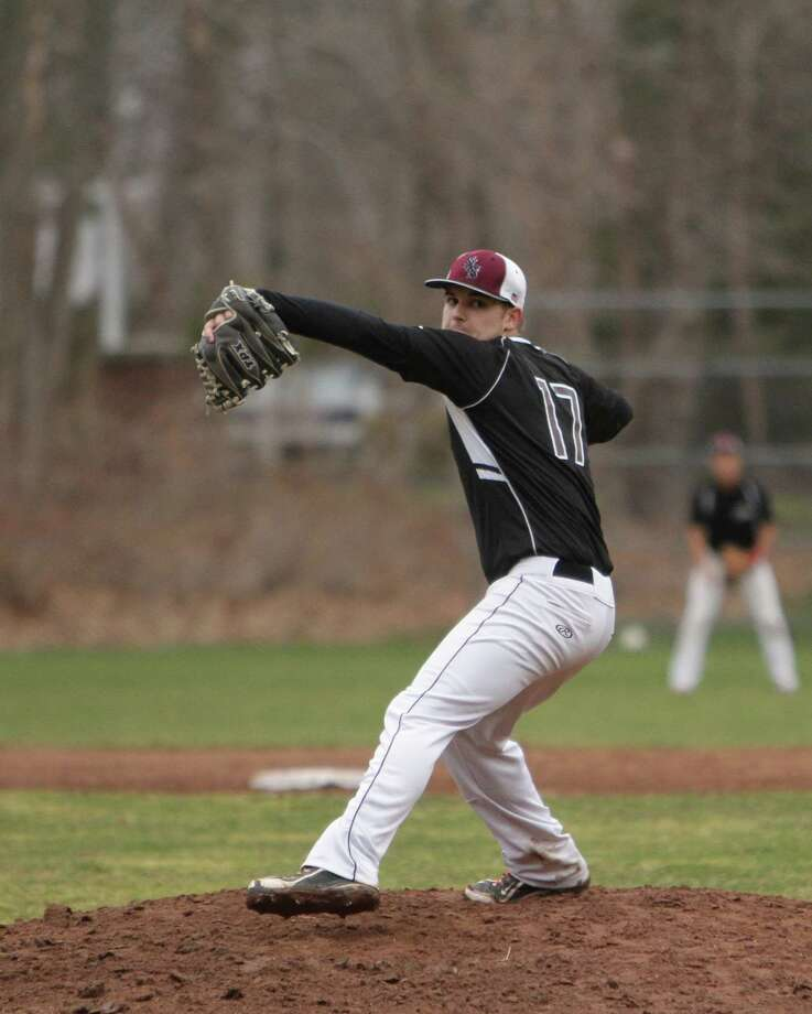 Senior Captain Ben Rappaport throws a pitch last Thursday in the Storm's home opener against Brunswick. St. Luke's fell to the Bruins 4-3. Photo: Desiree Smock / New Canaan News