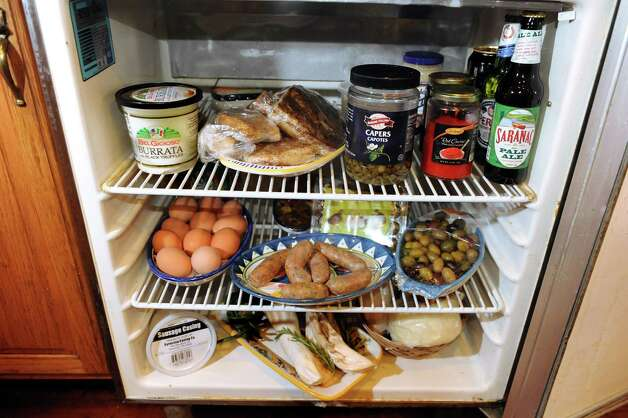 The contents of Jim Rua's compact fridge in his private kitchen on Wednesday, April 1, 2015, in Albany, N.Y. (Cindy Schultz / Times Union) Photo: Cindy Schultz / 00031257A
