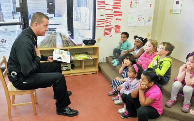 "Albany County Sheriff Craig Apple reads to a pre-K class during an Club Fed Child Care Center's ""Our Family Reads!"" project event at the Leo O'Brien Federal Building Wednesday, April 15, 2015, in Albany, N.Y.  (John Carl D'Annibale / Times Union) Photo: John Carl D'Annibale / 00031441A"