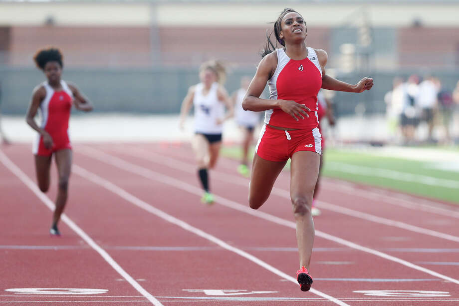 Judson's Kiana Horton crosses the finish line of the 400-meter dash during the Thunderbird Relays at Rutledge Stadium on April 9, 2015. Horton won the event with a time of 54.30 seconds. Horton also won the 100-meter dash and ran a leg on the Rockets' first place 400-meter relay. Photo: Marvin Pfeiffer /San Antonio Express-News / Express-News 2015