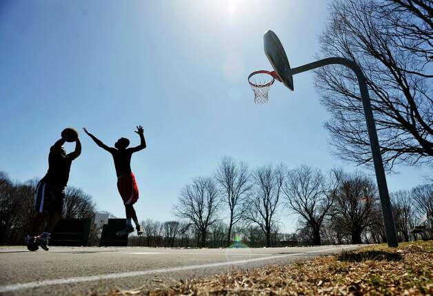 C.J. Nesmith, left, 12, from Troy and T.J. Harper, 13, from Troy basketball at Prospect Park on Sunday, April 12, 2015, in Troy, N.Y.   (Paul Buckowski / Times Union) Photo: Albany Times Union