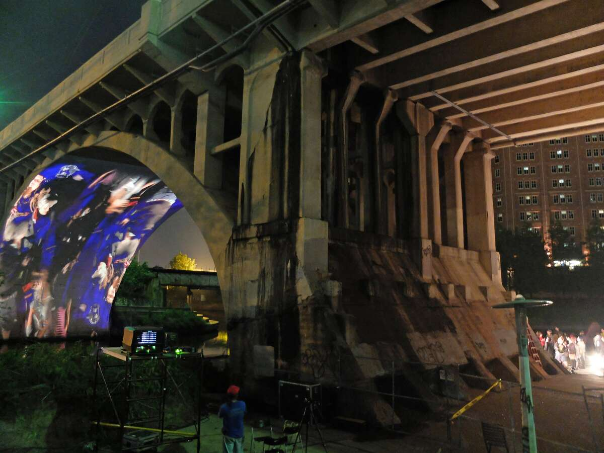 """A view of the Main Street Viaduct on Tuesday, April 14, 2015, when a crowd celebrating the opening of CounterCurrent 15 gathered to watch Luke Savisky's layered, part-live projection """"Ht/X""""."""