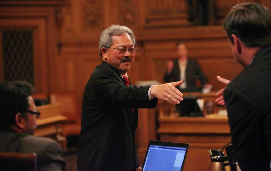 San Francisco Mayor Ed Lee (center) shakes hands with Supervisor Mark Farrell before answering questions from the Board of Supervisors during policy discussions about the proposed Airbnb ordinance at City Hall in 2011. Photo: Lea Suzuki / The Chronicle / SFC