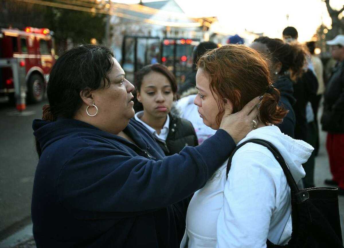 Veronica Alvarez, right, is comforted by her aunt, Juana Alvarez, after losing all of her family's possessions, as well as their dog, in a house fire at 528/530 Connecticut Avenue in Bridgeport on Monday, March 8, 2010.