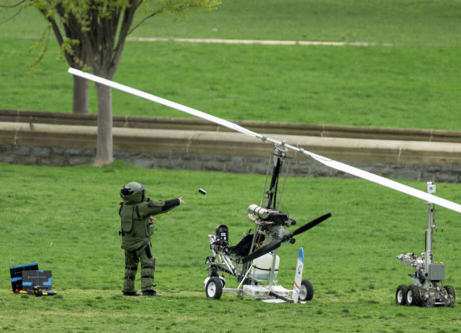 "A bomb squad member examines the ""gyrocopter"" that was landed on the Capitol's West Lawn. Photo: Andrew Harnik / Associated Press / AP"
