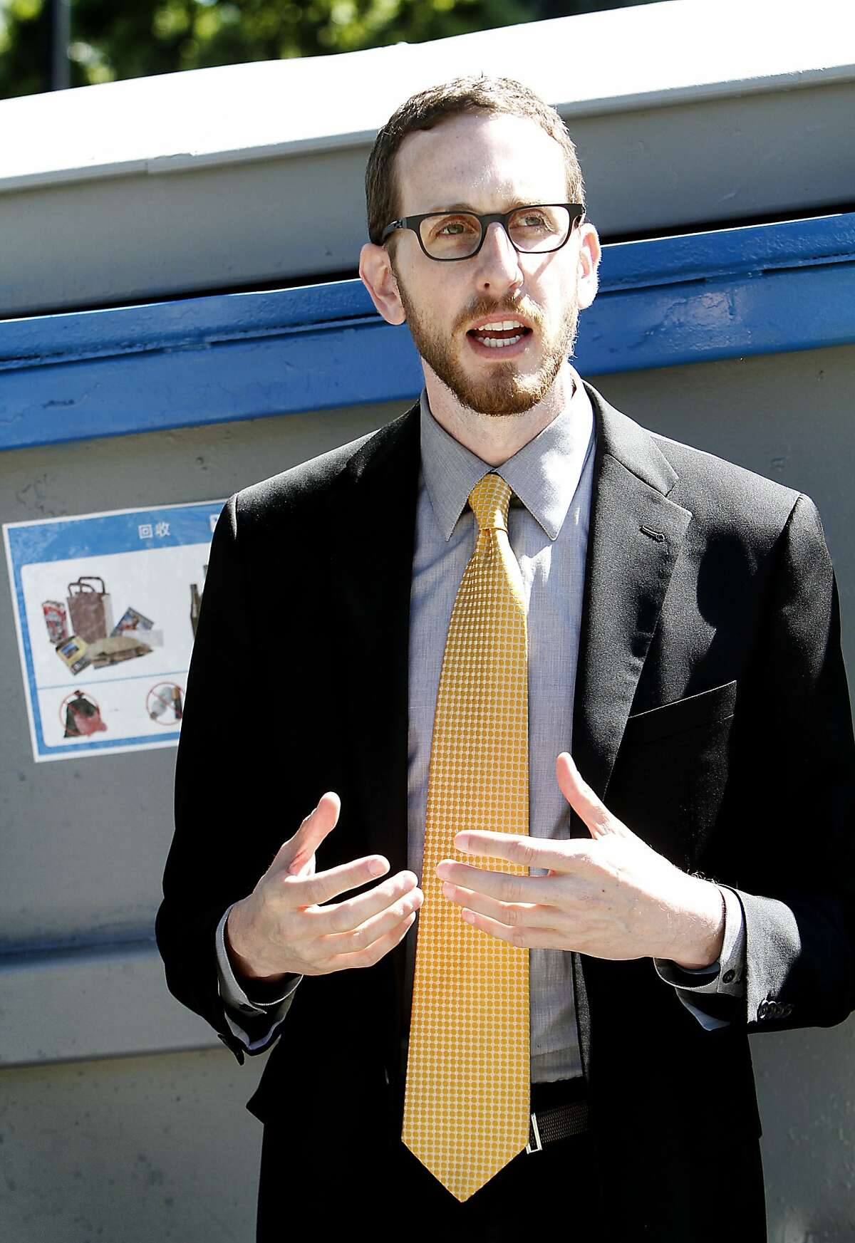Supervisor Scott Wiener talks to the press at a new pop-up recycling and composting location meant to curb the trash problem at Dolores Park in San Francisco, Calif., on Wednesday, April 15, 2015.