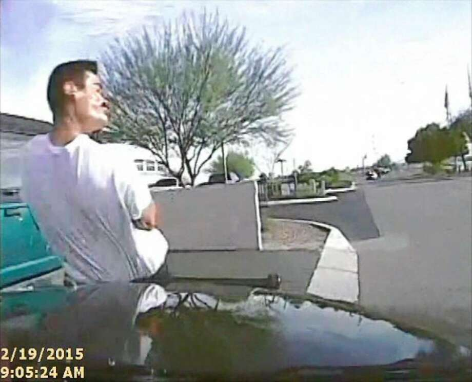 In this Feb. 19, 2015, frame grab from a dash cam video provided by the Marana Police Department, a police vehicle hits Mario Valencia in Marana, Ariz. Dramatic dash cam video released Tuesday, April 14 shows a police officer using his cruiser to ram the armed suspect, Valencia, sending him flying in the air before the car smashes into a wall. Valencia survived the crash, and prosecutors cleared the officer of any wrongdoing. (Marana Police Department via AP) Photo: Associated Press
