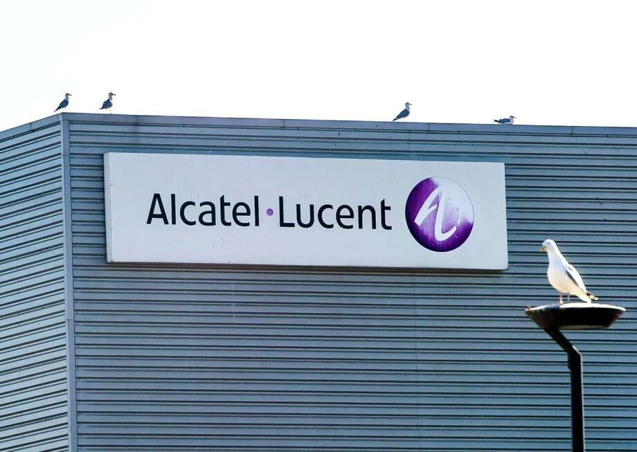 Photo taken on April 15, 2015 shows seagulls sitting on the building of French telecommunications equipment company Alcatel-Lucent in Calais, northern France. Nokia has struck a 15.6-billion-euro deal to buy its rival Alcatel-Lucent to create the world's biggest supplier of mobile phone network equipment, both firms said on April 15. AFP PHOTO / PHILIPPE HUGUENPHILIPPE HUGUEN/AFP/Getty Images Photo: PHILIPPE HUGUEN / AFP / Getty Images / AFP