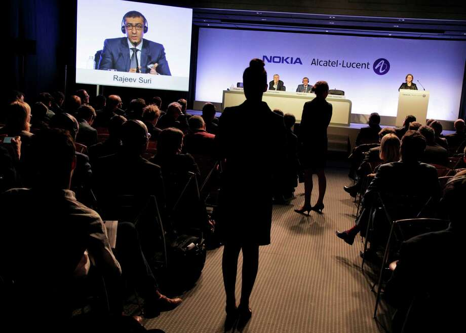 Nokia CEO Rajeev Suri discusses the acquisition of Alcatel-Lucent in a news conference in Paris. Photo: Kosuke Okahara / Bloomberg / © 2015 Bloomberg Finance